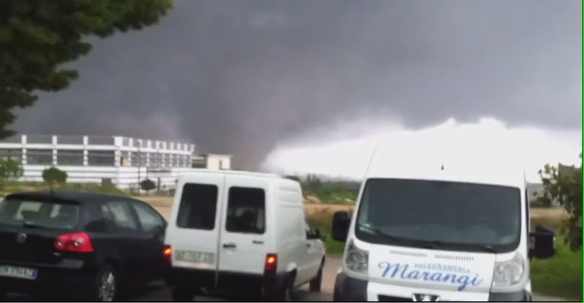 Watch These Italians Almost Getting Killed By A Gigantic Tornado